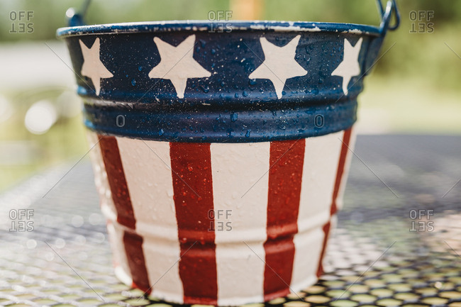 Close-up of a bucket with American flag print