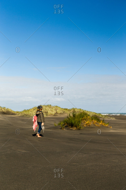 Woman watching sea from a beach