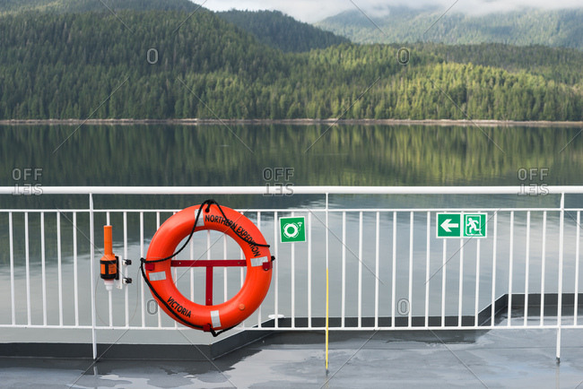 Prince Rupert, British Columbia, Canada - June 16, 2017: Dense green forest lines the shore as seen from a ferry deck