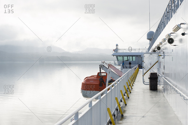 Prince Rupert, British Columbia, Canada - June 14, 2017: View of misty mountains and calm ocean waters from ferry deck