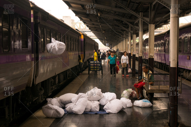 Bangkok, Thailand - March 21, 2015: Unloading dirty linen from the sleeper train