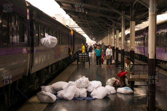 Bangkok, Thailand - March 21, 2015: Unloading dirty linen from the sleeper train