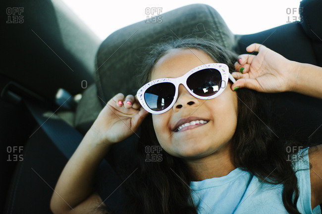 Girl wearing sunglasses in car