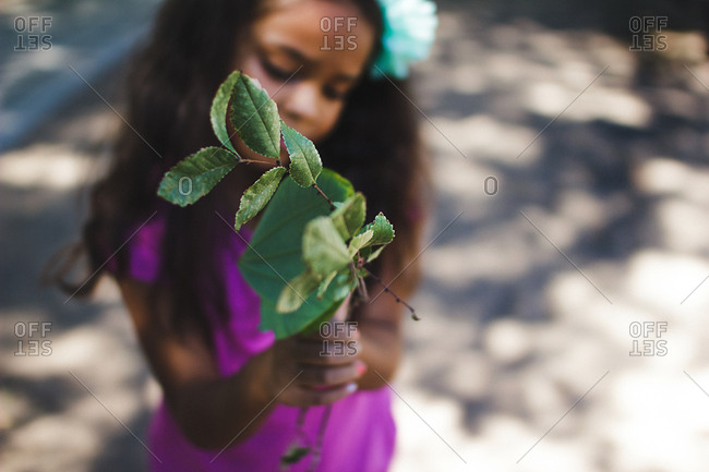 Girl with a branch in hands