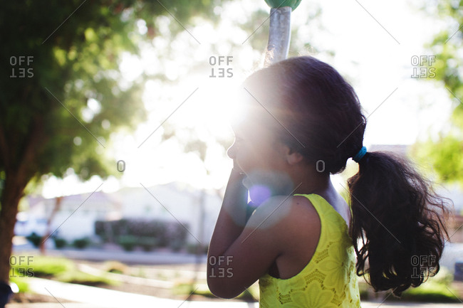 Girl outside in summer sunlight