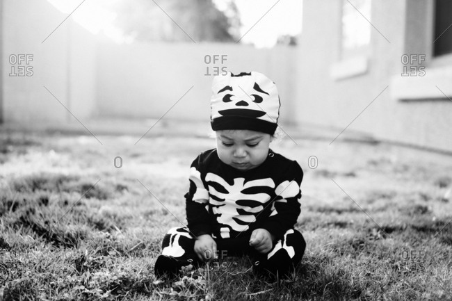 Toddler in yard in bone costume