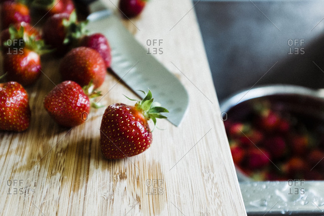 Strawberries by a sink