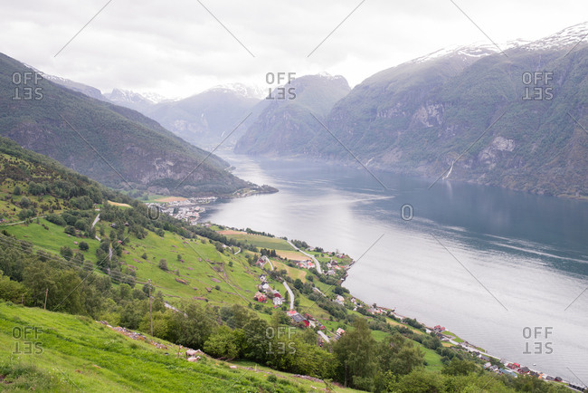 Scenic view of village and fjord