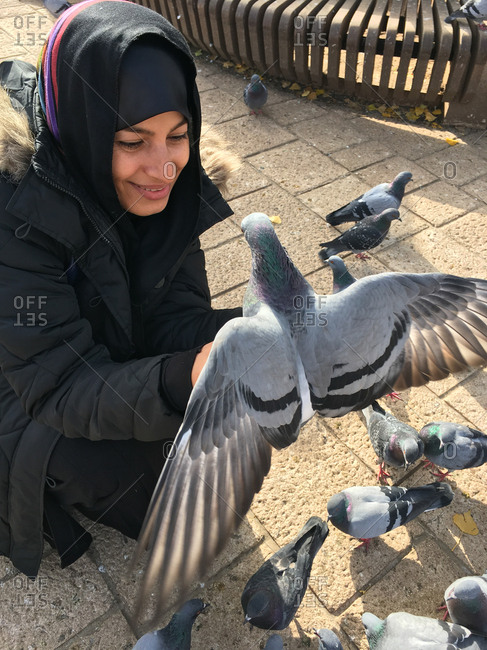 Middle eastern woman with pigeon