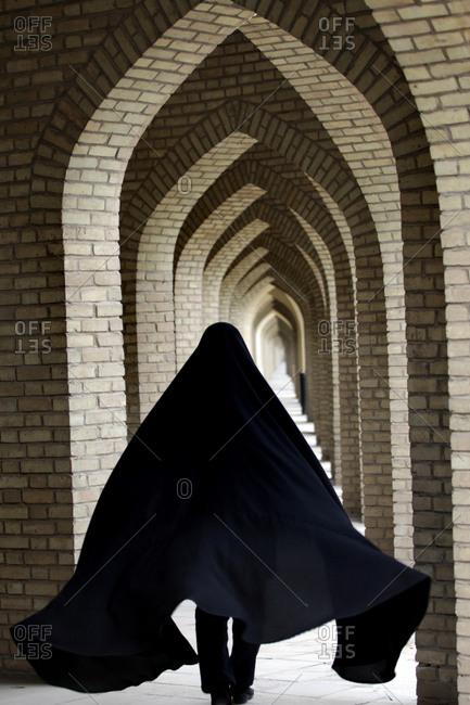 Muslim woman wearing hijab and walking