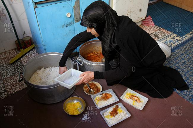 Muslim people preparing food for iftar in Ramadan