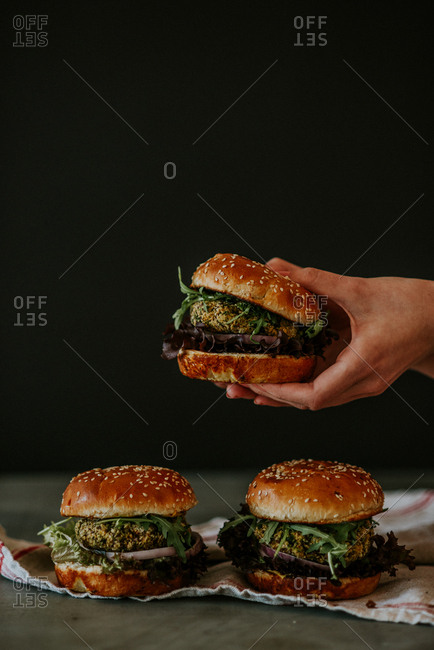 Woman's hands holding a beetroot burger