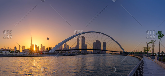 Dubai, UAE  - April 21, 2017: Canal Bridge and bay at sunrise