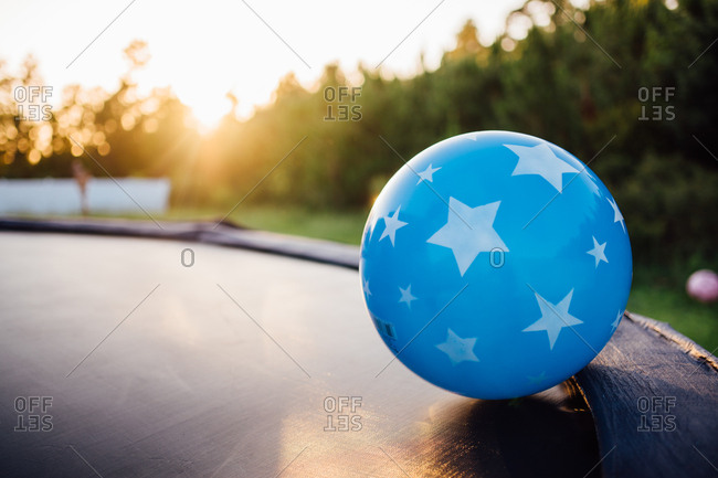 Large bouncing ball at the edge of a trampoline