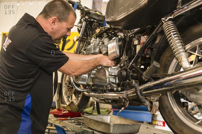 motorcycle mechanic at work motorcycle mechanic at work