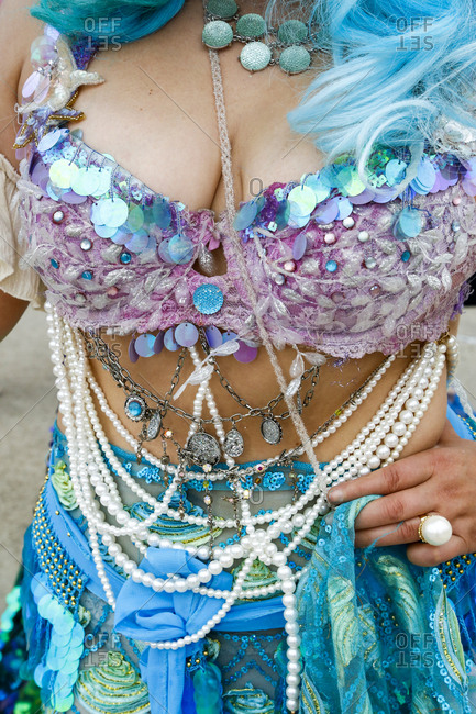 A woman displays her Mermaid costume