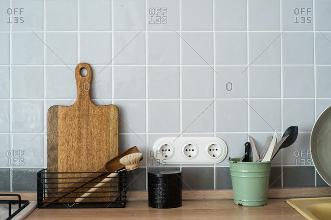 Tidy kitchen counter with cutting board and utensils