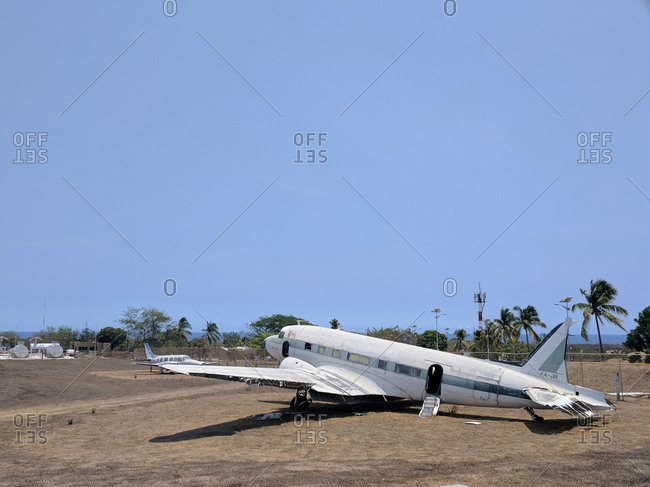 Old airplane left in field
