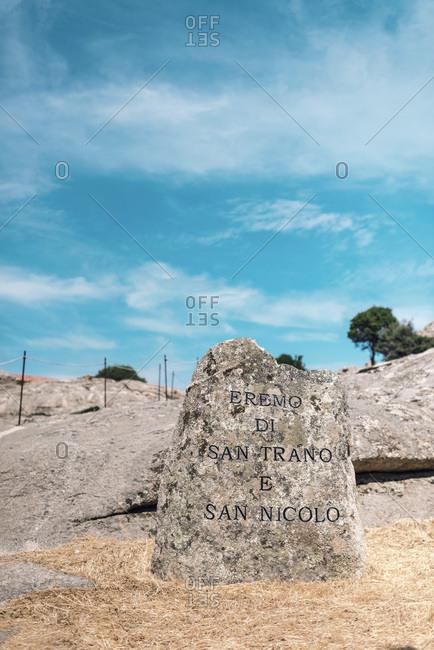 Sardinia, Italy - June 12, 2017: Entrance of ancient church in mountains Chiesa di San Trano Luogosanto Sardinia