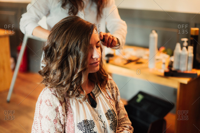 Woman having hair curled for a wedding