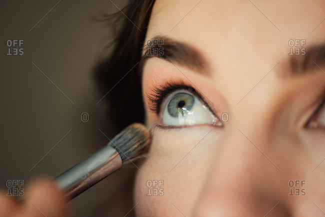 Woman having eye shadow applied for a wedding
