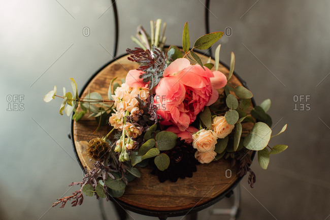 Floral arrangement on a wooden stool