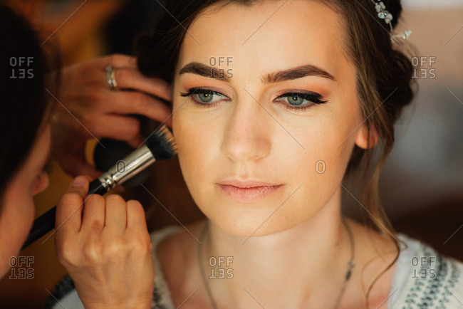 Bride having foundation applied for a wedding