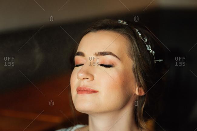 Bride having makeup set for her wedding