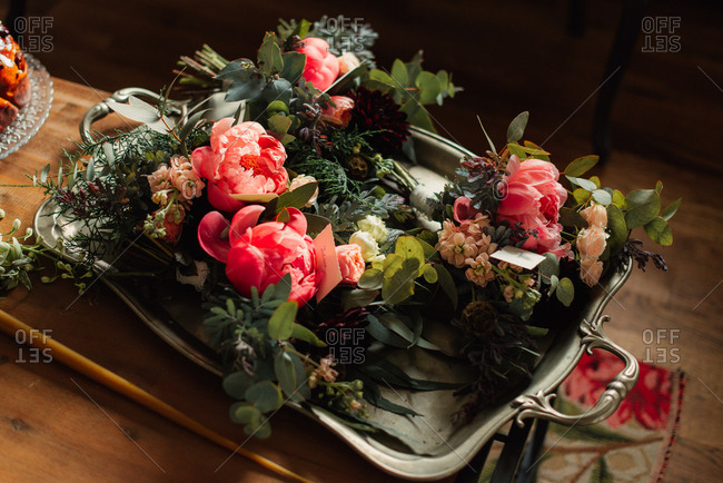 Tray filled with small bouquets for bridesmaids