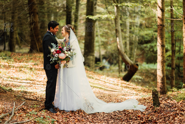 Happy bride and groom in the woods
