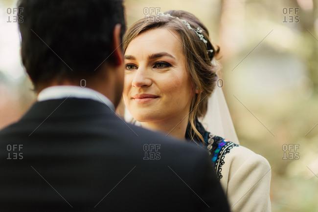 Bride looking into her groom's eyes