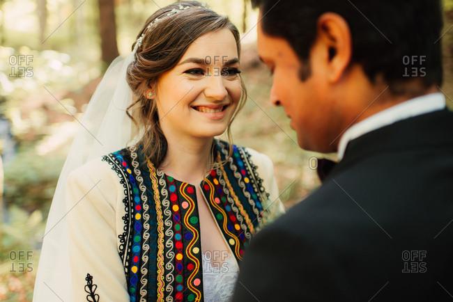 Happy bride looking into her groom's eyes