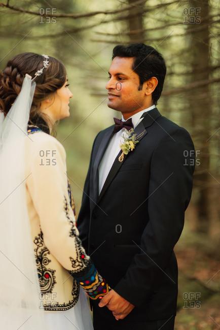 Groom looking into his bride's eyes