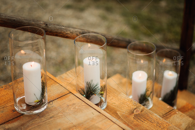 Candles in glass jars on wooden steps