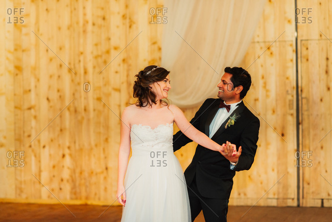 Groom and bride dancing at their wedding reception