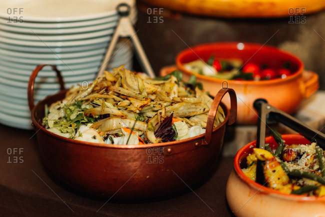 Bowls with food at a wedding reception