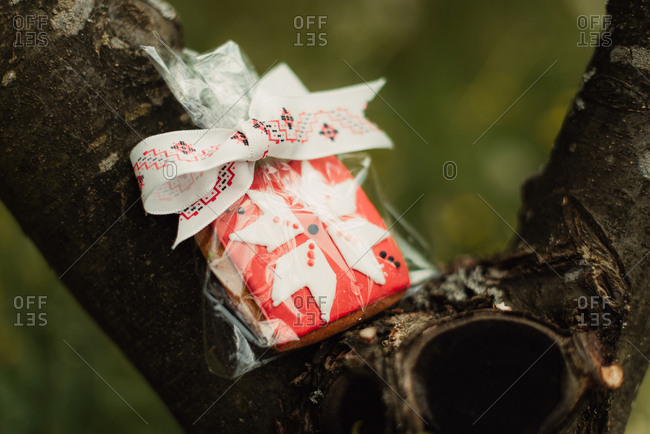 Packaged cookie with pink and white icing on a tree