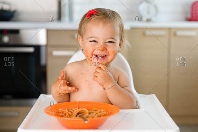 Happy toddler messy from food