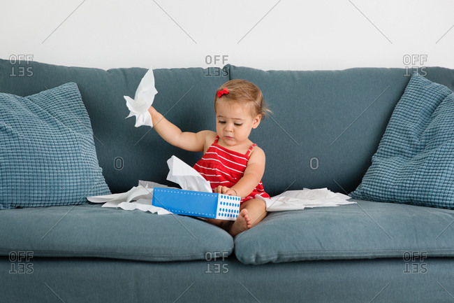 Toddler pulling tissues from box