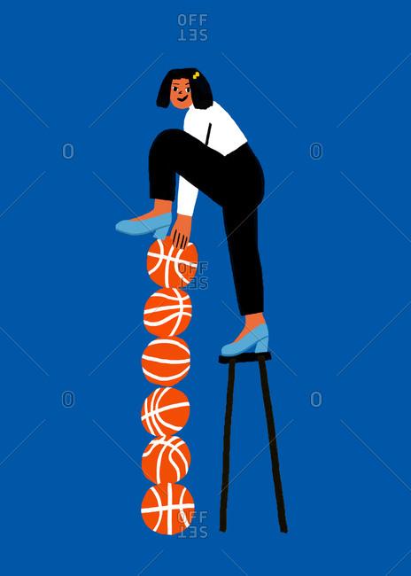 Woman balancing basketball stack