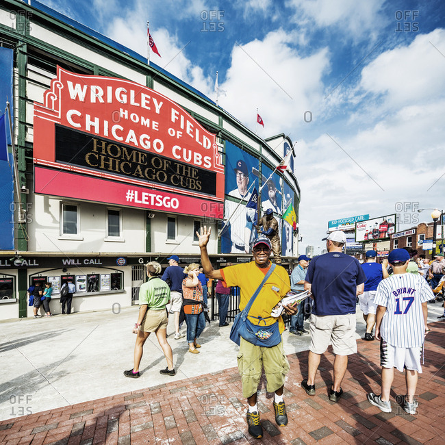 Chicago, Illinois, USA - June 20, 2017: Wrigleyville, independent magazine seller near the exterior of the Wrigley Field before a Chicago Cubs match