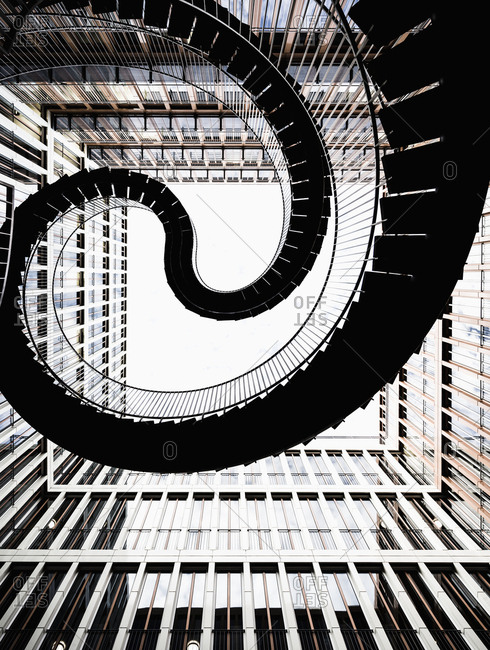 Munich, Bavaria, Germany - June 20, 2017: Umschreibung sculpture, The Infinite or Endless Staircase, by Olafur Eliasson in a courtyard