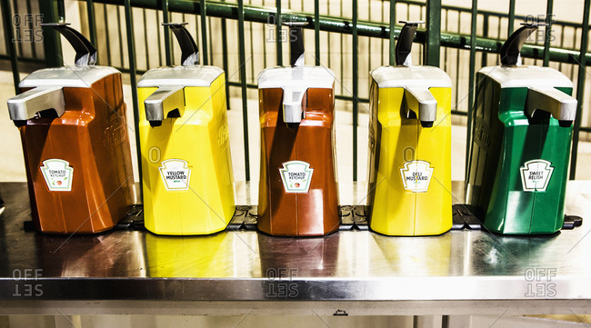 Chicago, Illinois, USA - June 20, 2017: Heinz Dispensers of Tomato Ketchup, Mustards and Sweet Relish at Wrigleyville