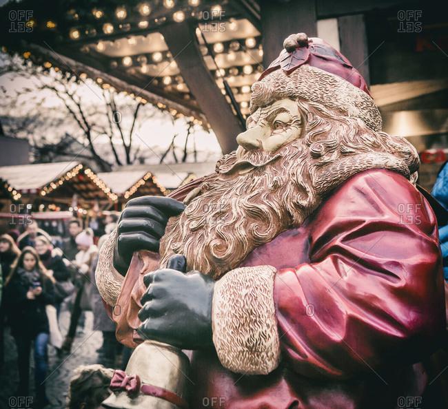 Christkindlmarkt, Christmas market at Sendlinger Tor, a statue of Santa Klaus