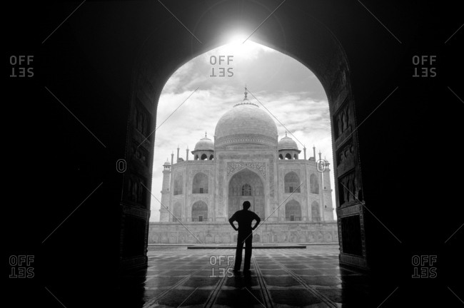 Person silhouetted by Taj Mahal