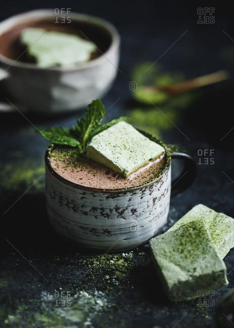 Green matcha marshmallows on fresh mint hot cocoa