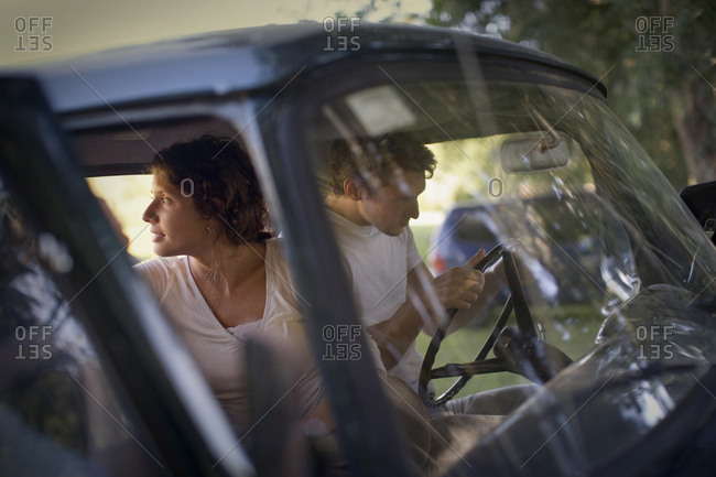 A couple preparing for a drive