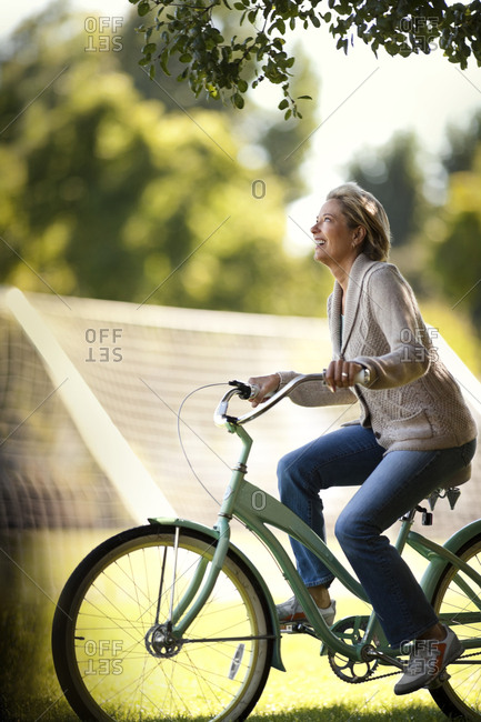 A woman riding her bike in a park