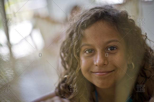 A young girl with curly brown hair