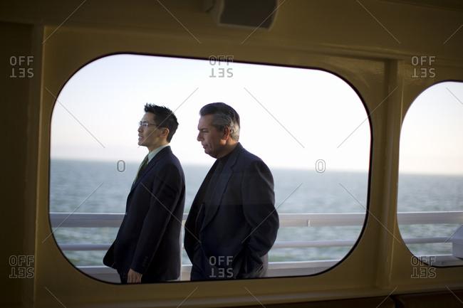 Two businessman walking on a boat deck
